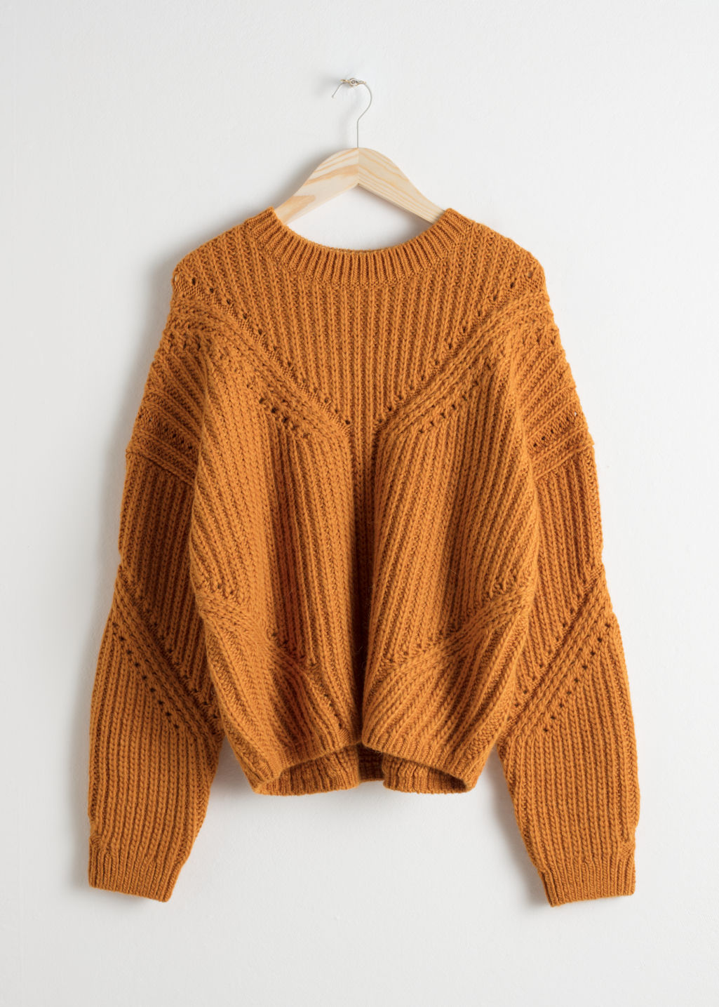 Front image of Stories oversized curved knit sweater in yellow