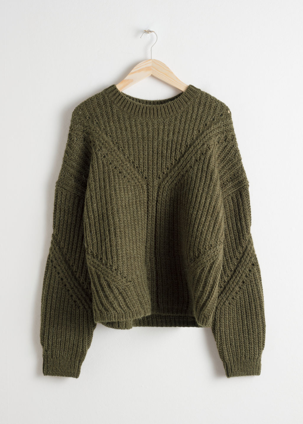 Front image of Stories oversized curved knit sweater in green