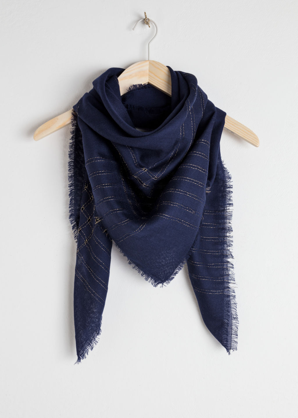 Front image of Stories metallic open knit wool scarf in blue
