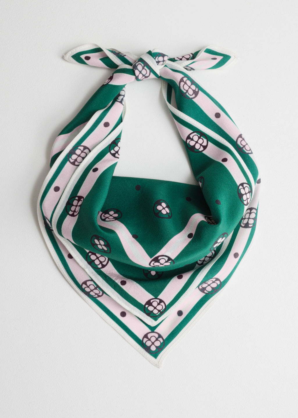 Front image of Stories printed silk neck scarf in green