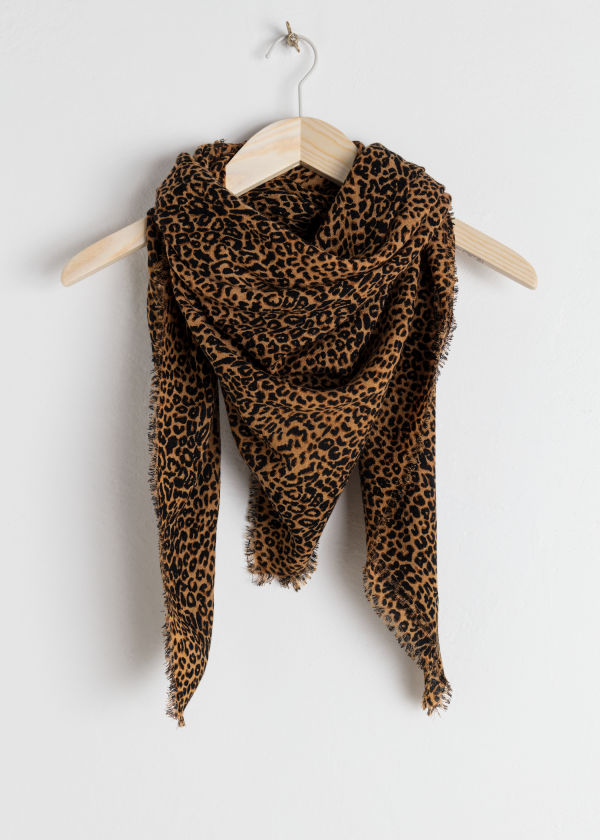 Front image of Stories leopard print wool scarf in orange