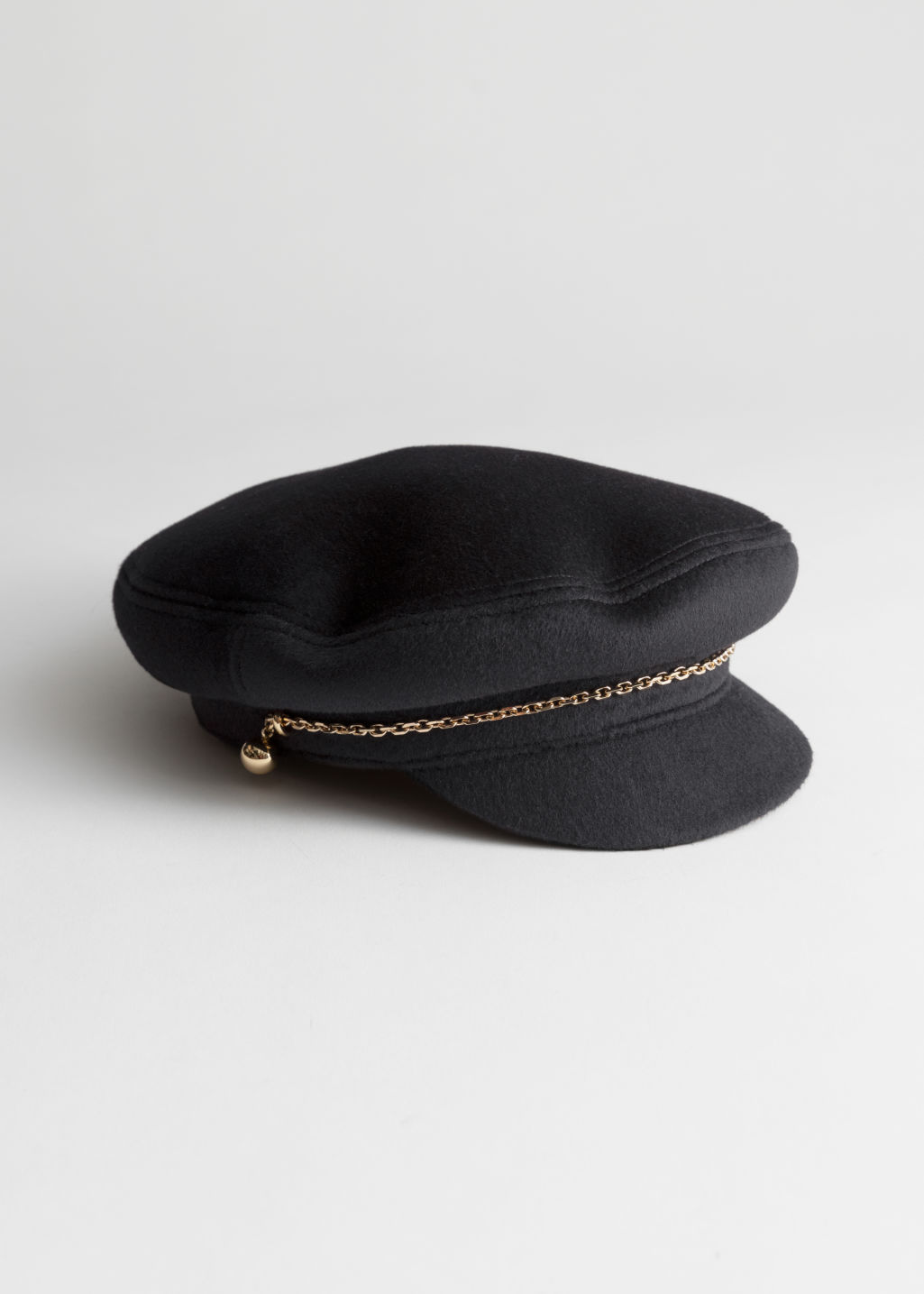 Front image of Stories chain wool blend baker boy cap in black