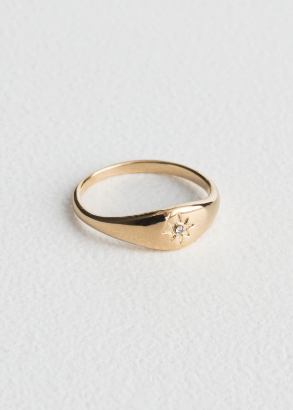 Front image of Stories star embossed ring in gold