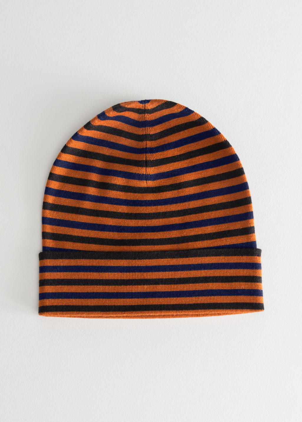Front image of Stories striped merino wool beanie in orange