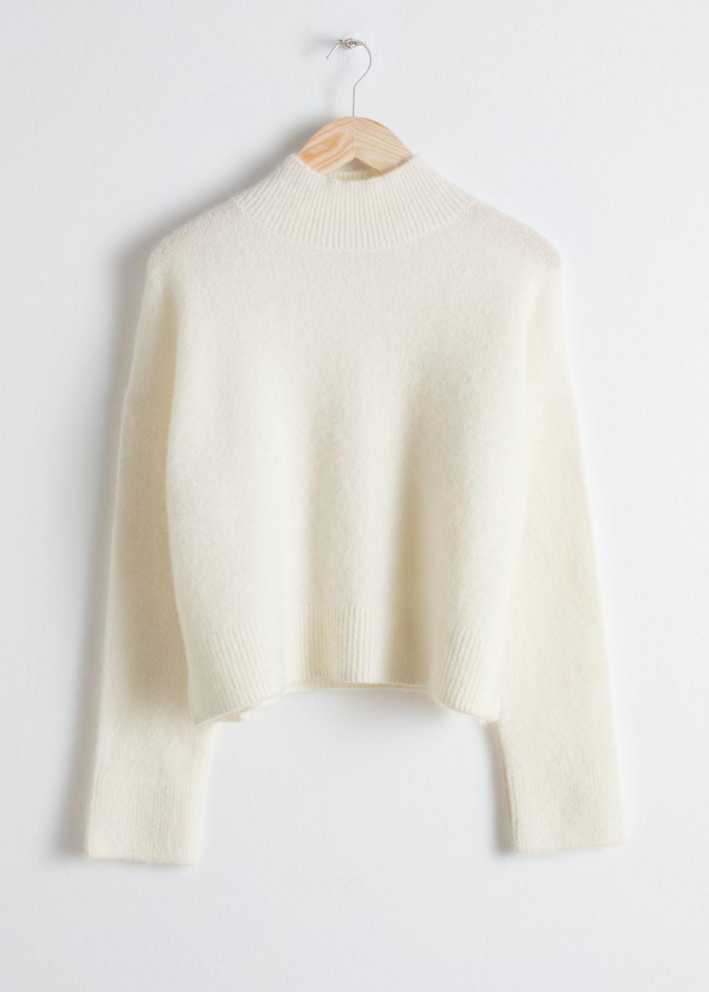 Front image of Stories wool blend cropped turtleneck in white