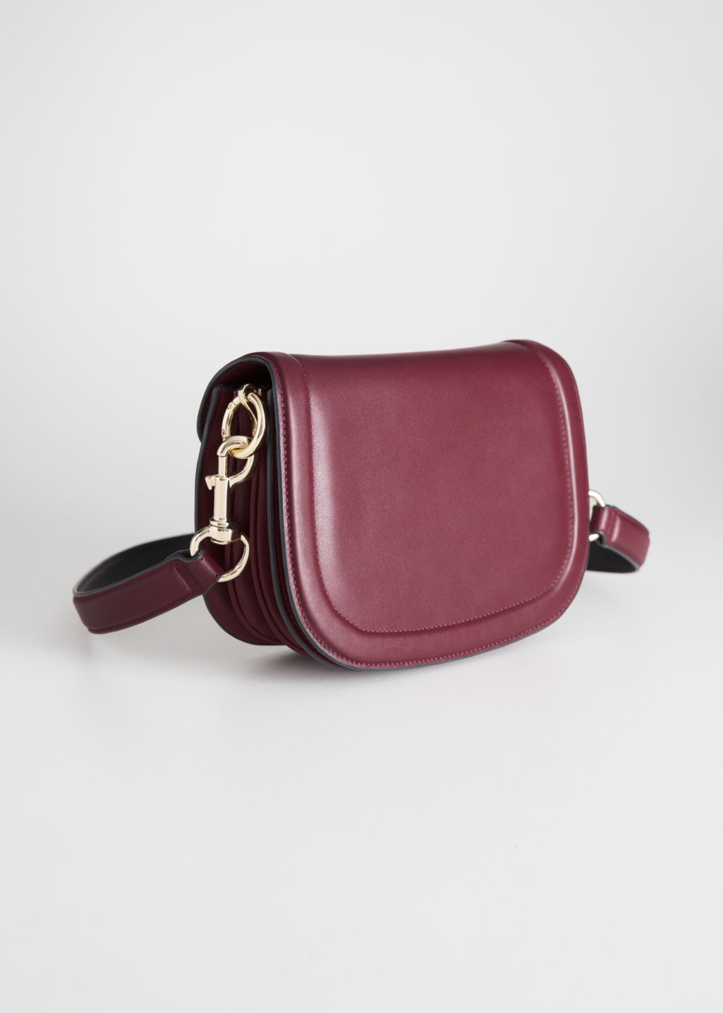 Front image of Stories leather mini saddle bag in red