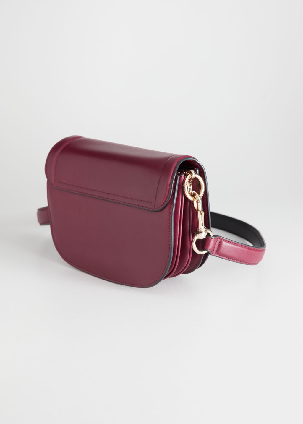 Back image of Stories leather mini saddle bag in red