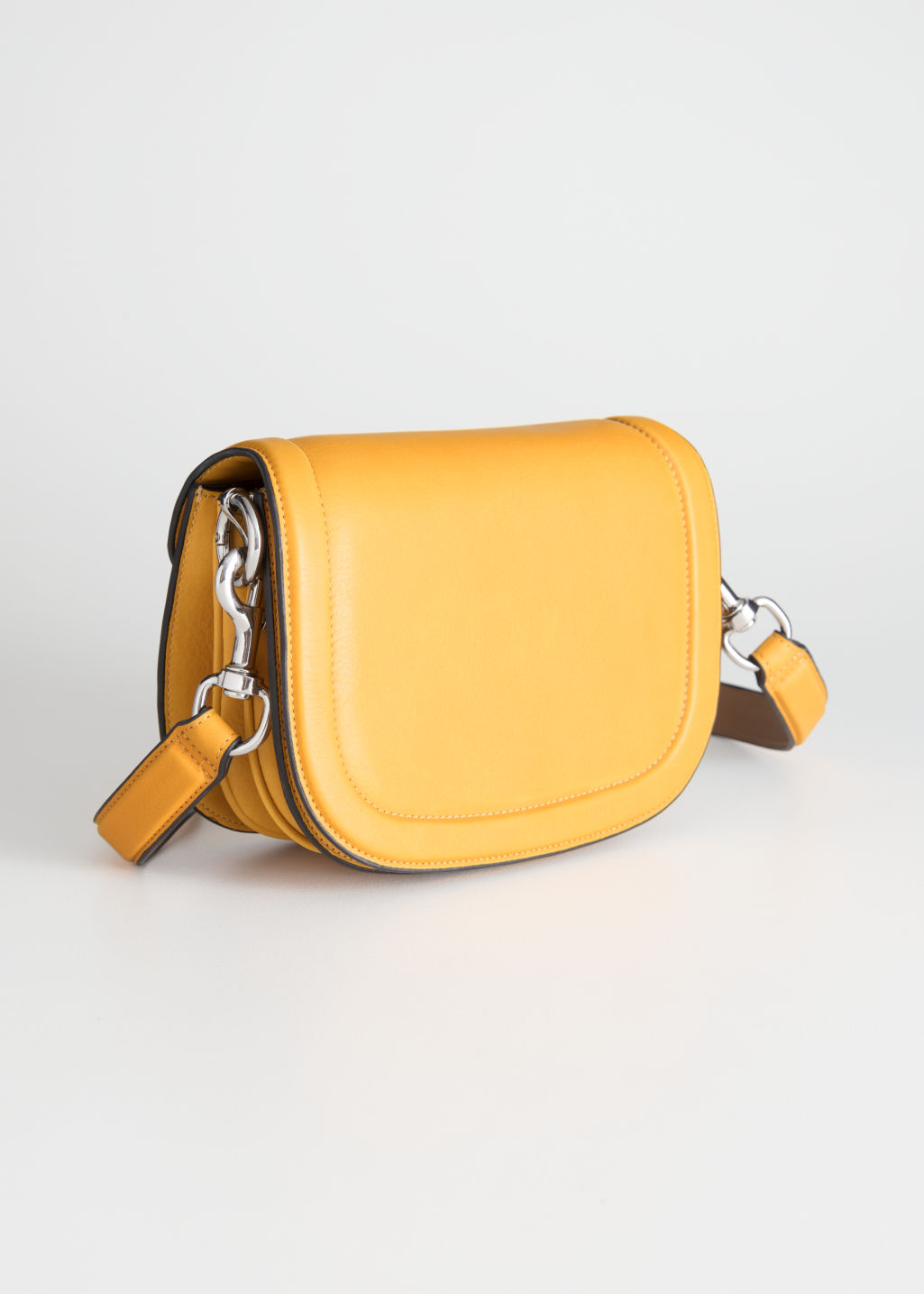 Front image of Stories leather mini saddle bag in yellow