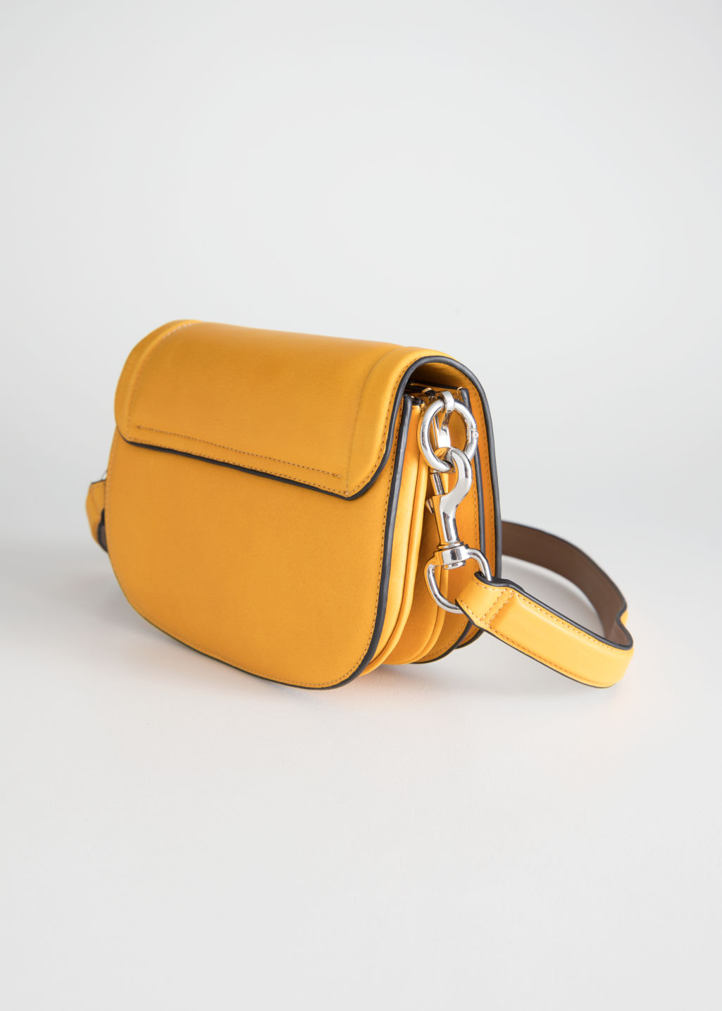 Back image of Stories leather mini saddle bag in yellow