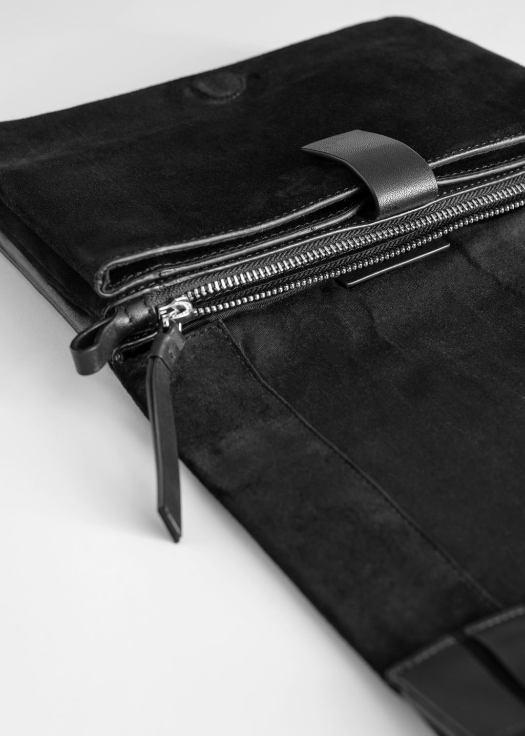 Back image of Stories leather strip crossbody bag in black