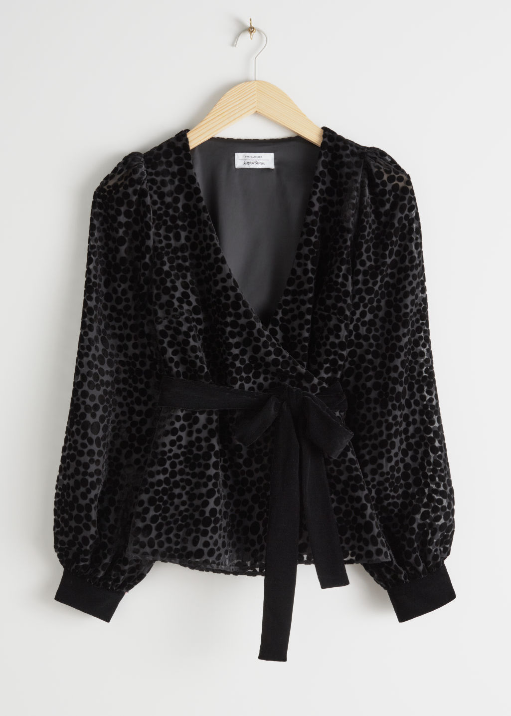 Front image of Stories velvet mesh wrap top in black