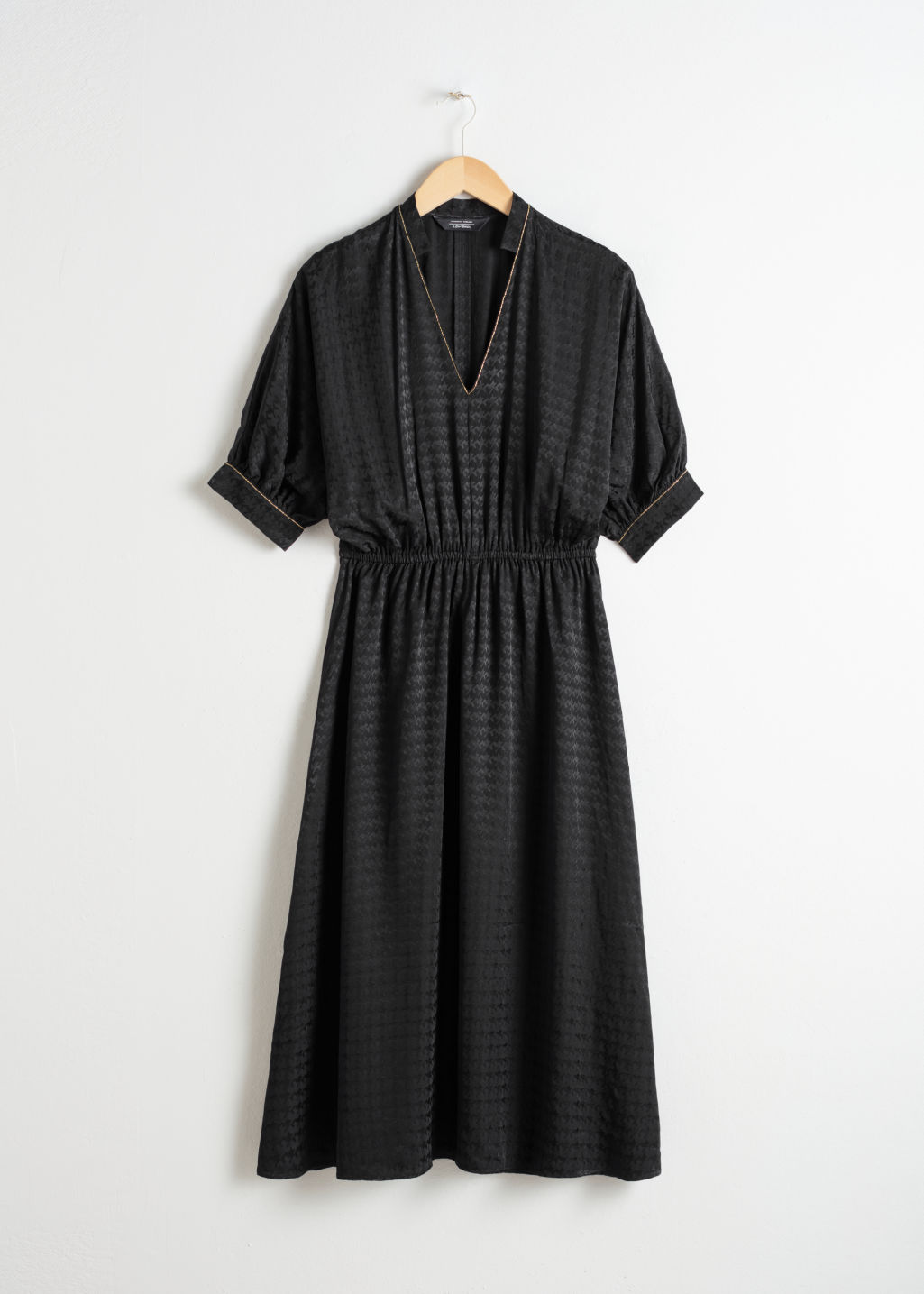 Front image of Stories houndstooth jacquard midi dress in black