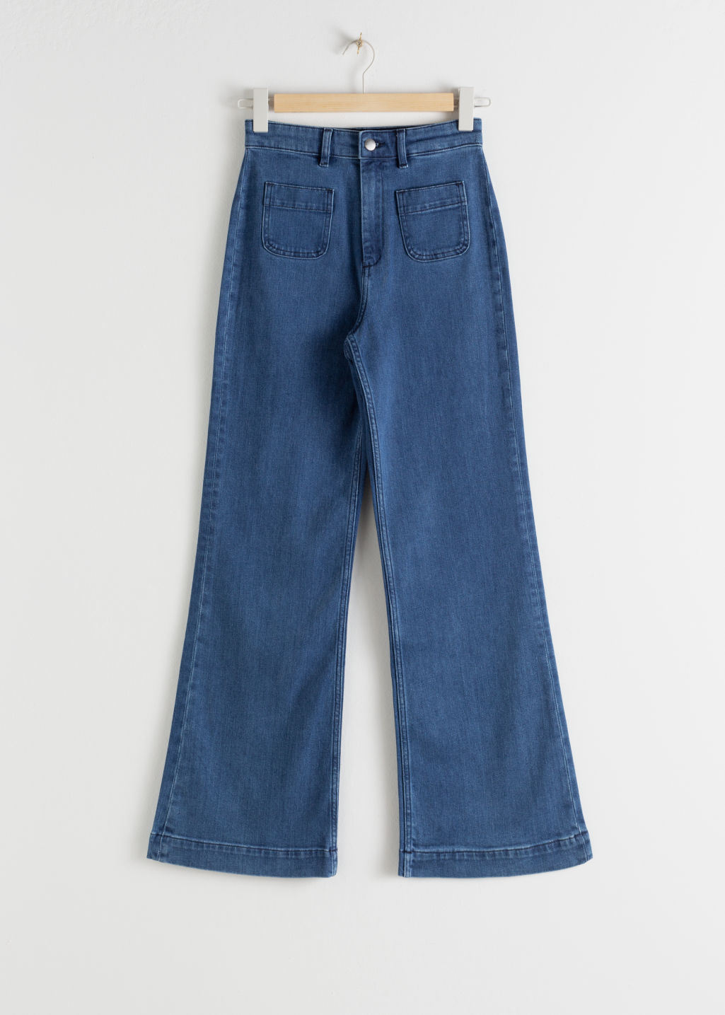 StillLife Front Image of Stories Flared High Rise Jeans in Blue