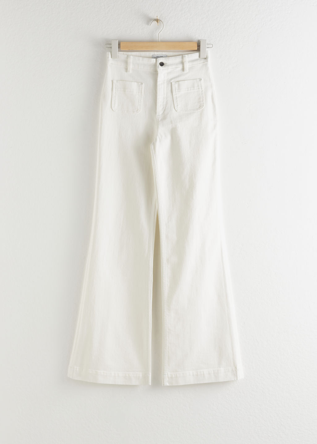 Front image of Stories flared mid rise jeans in white