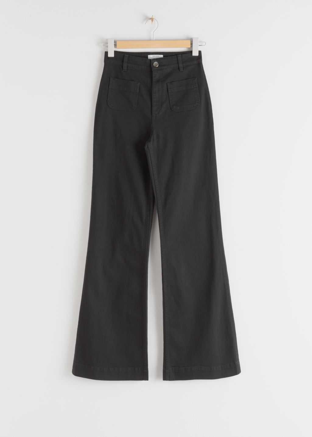 Front image of Stories flared mid rise jeans in black