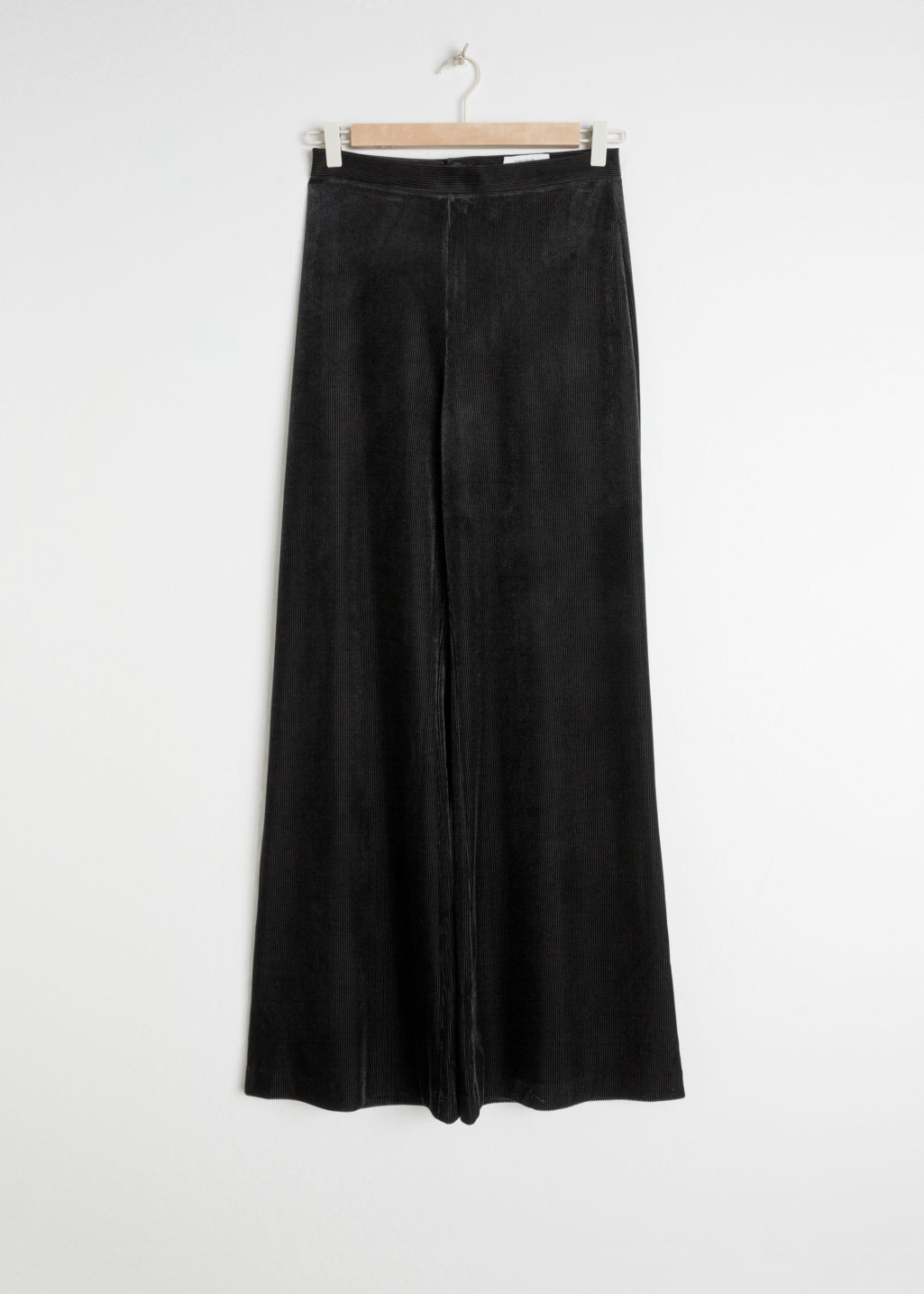 Front image of Stories flared velour trousers in black