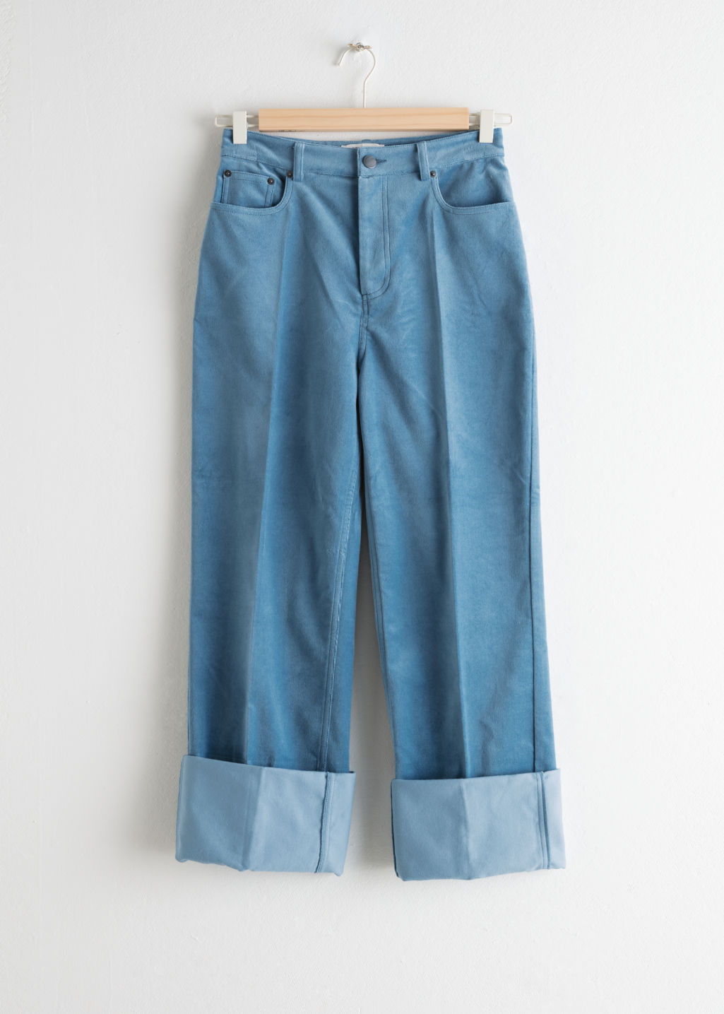 Front image of Stories velvet cuffed trousers in blue