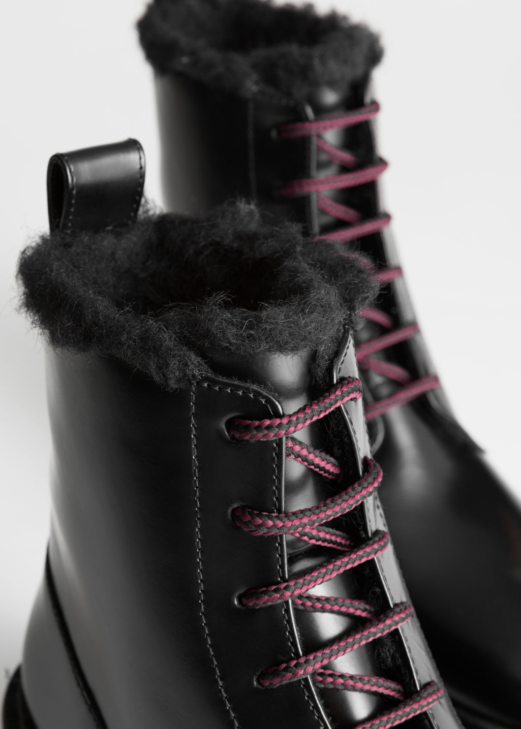 Back image of Stories lace up leather boots in black
