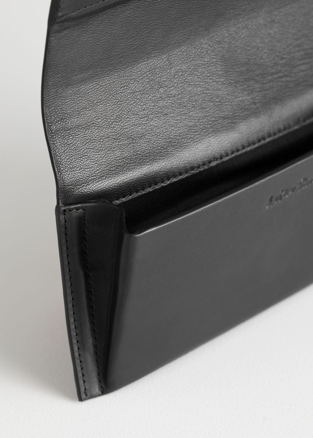 Back image of Stories leather glasses case in black