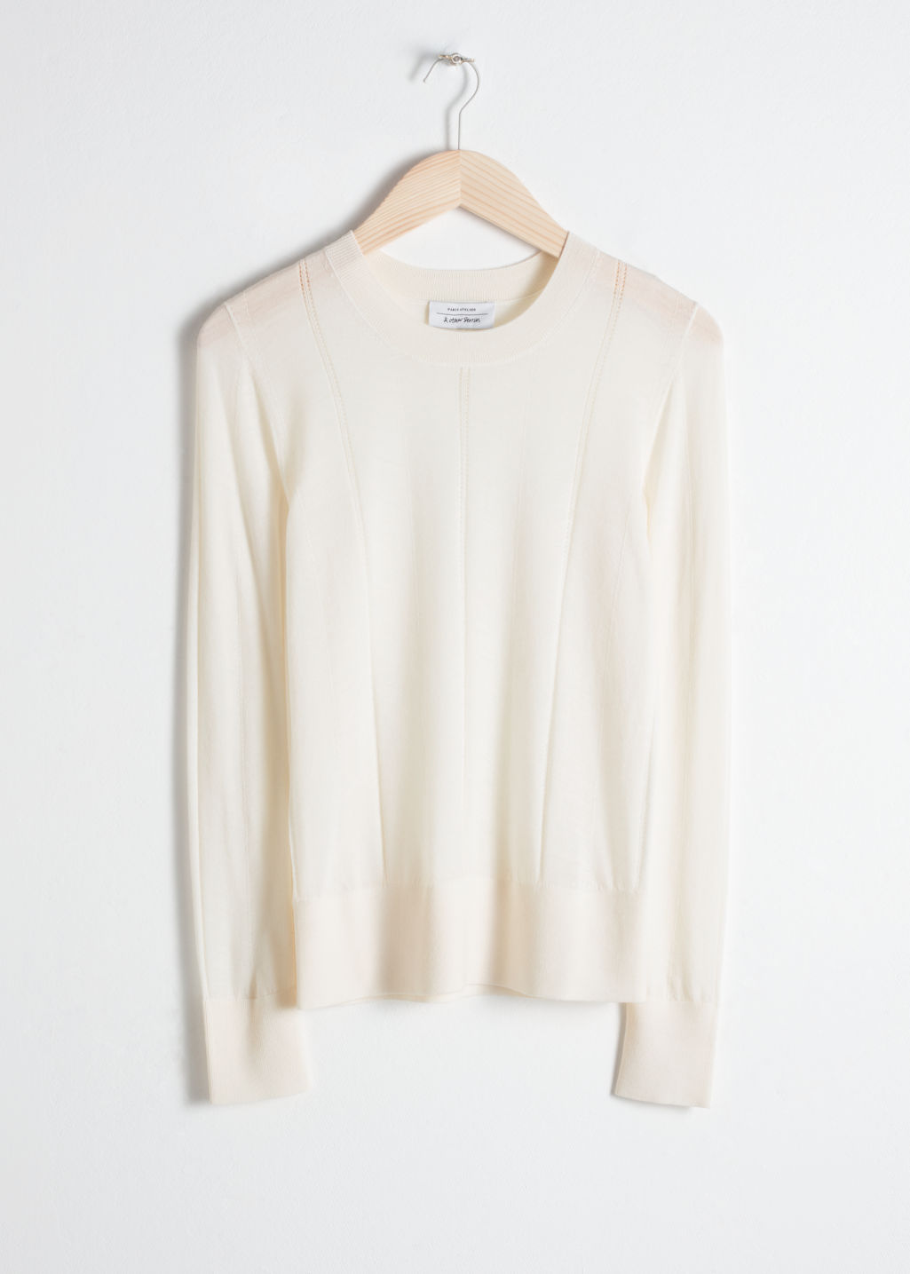 Front image of Stories merino wool sweater in white
