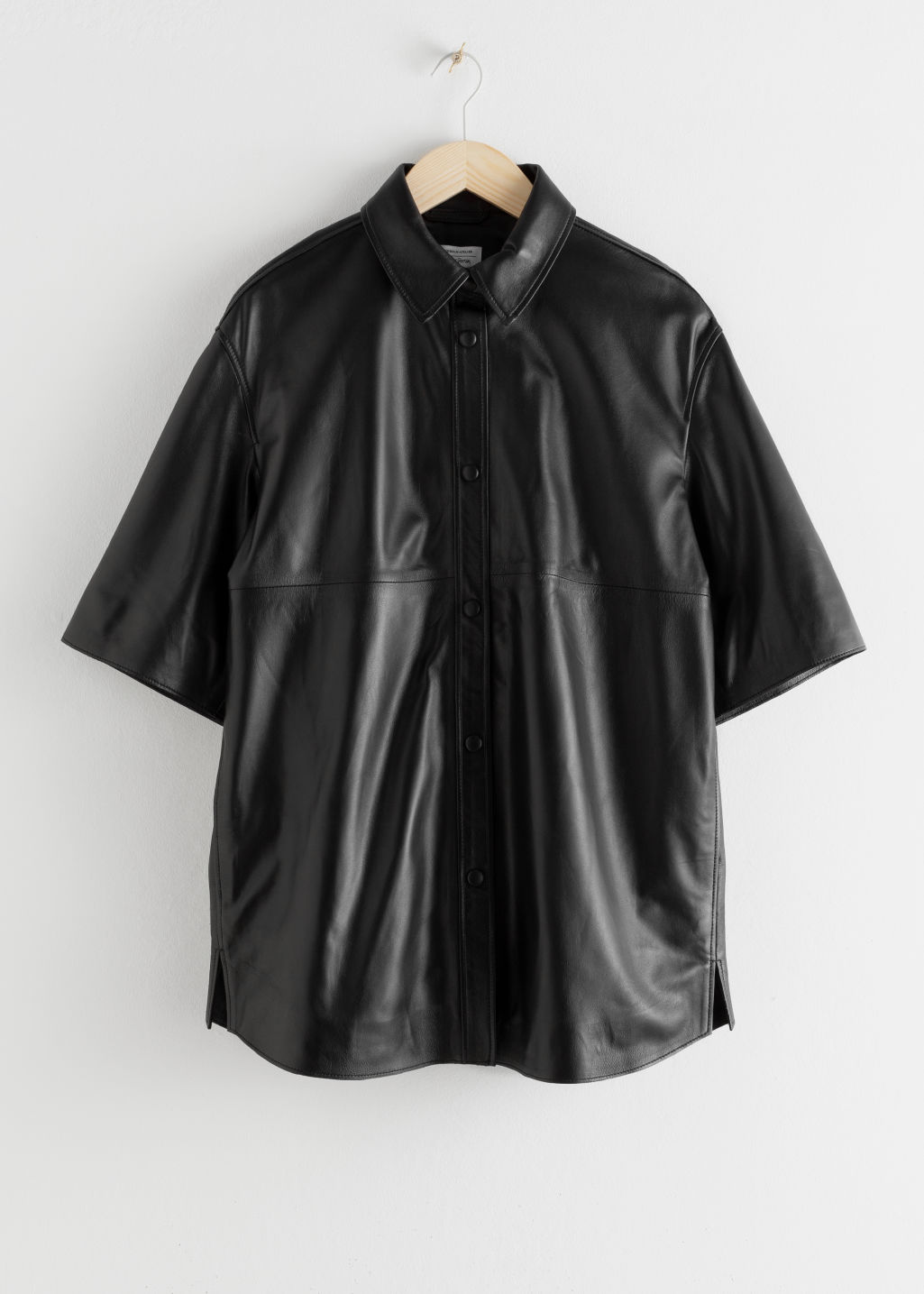 Front image of Stories leather button down overshirt in black