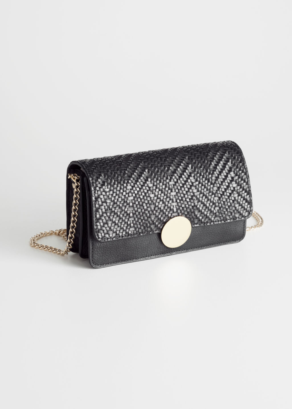 Front image of Stories chevron woven leather crossbody in black