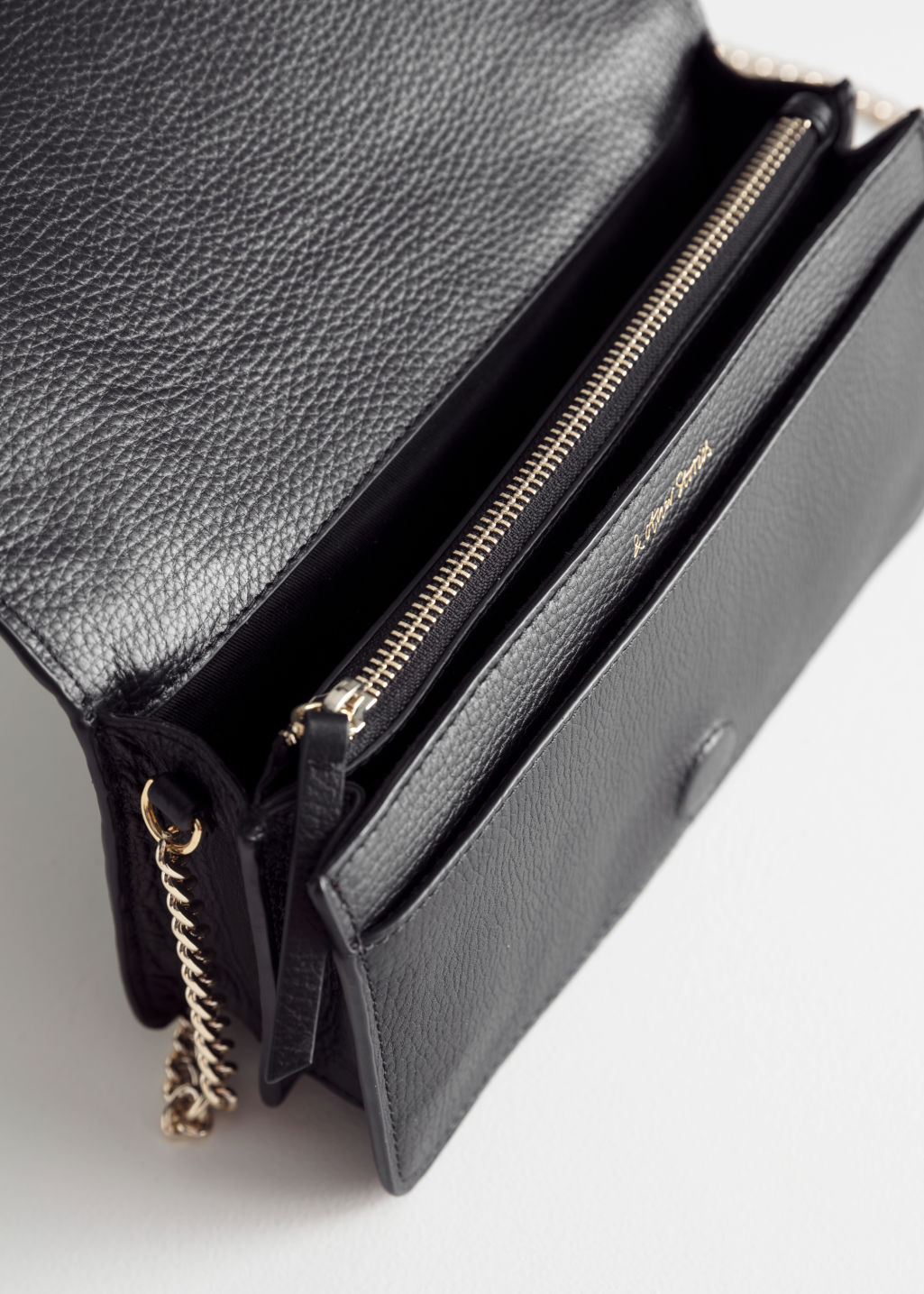 Back image of Stories chevron woven leather crossbody in black