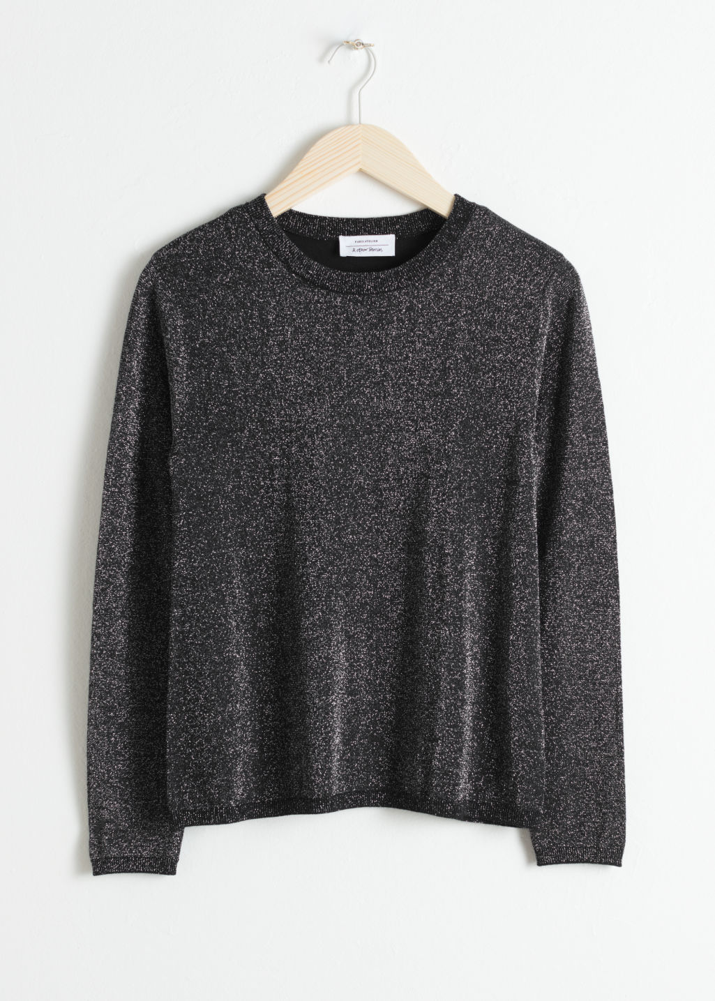 Front image of Stories wool blend glitter sweater in black