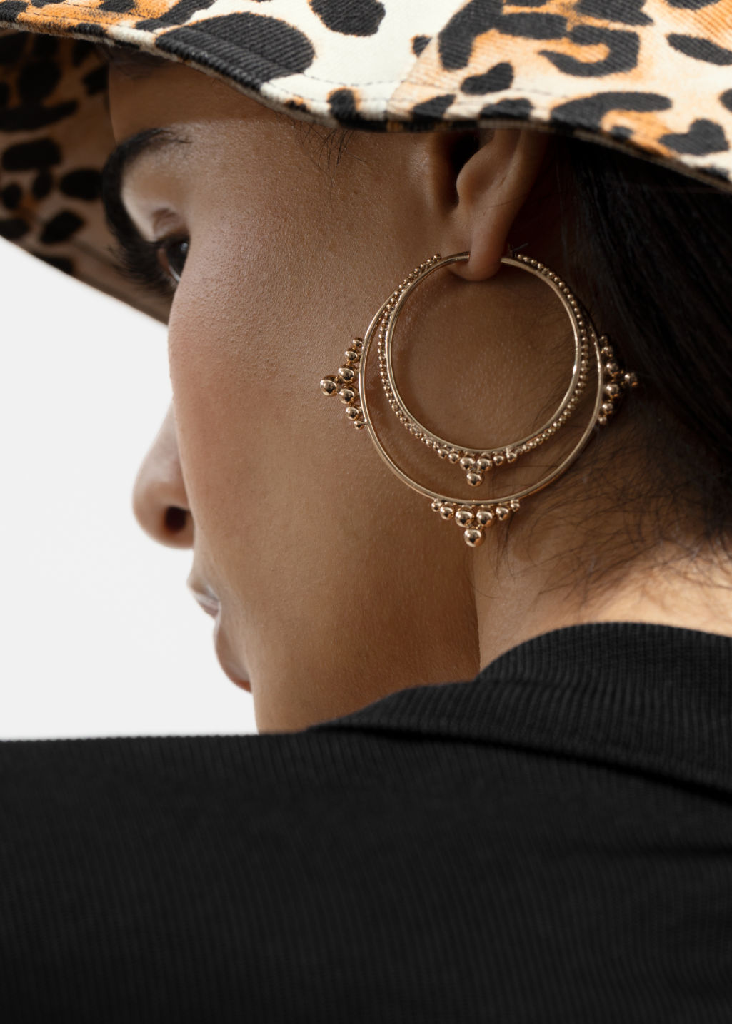Back image of Stories ball stud hoop earrings in gold