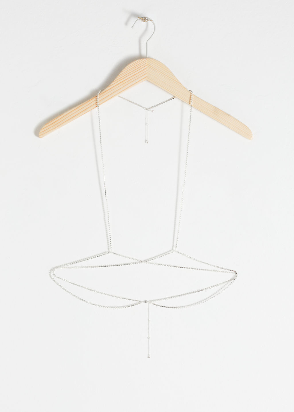 Front image of Stories harness body chain in white