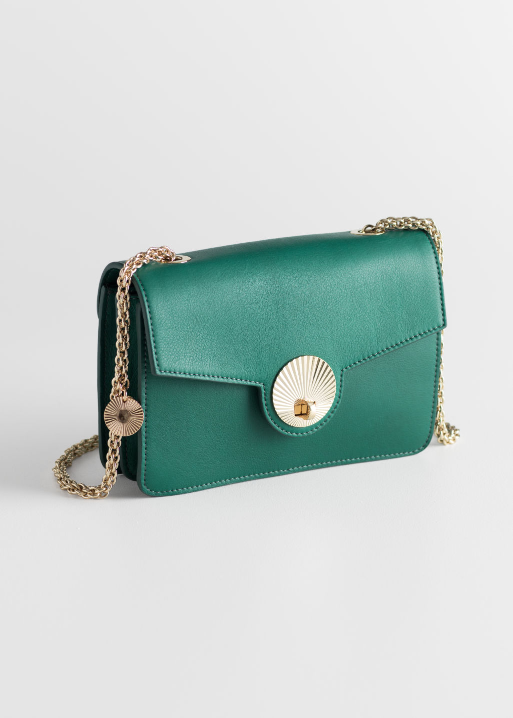 Front image of Stories embossed lock crossbody bag in green