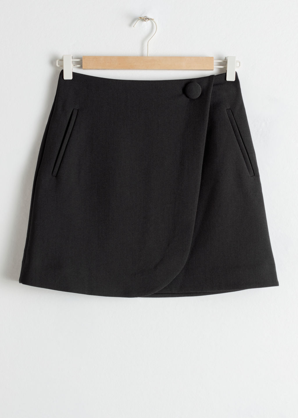 Front image of Stories wrap mini skirt in black