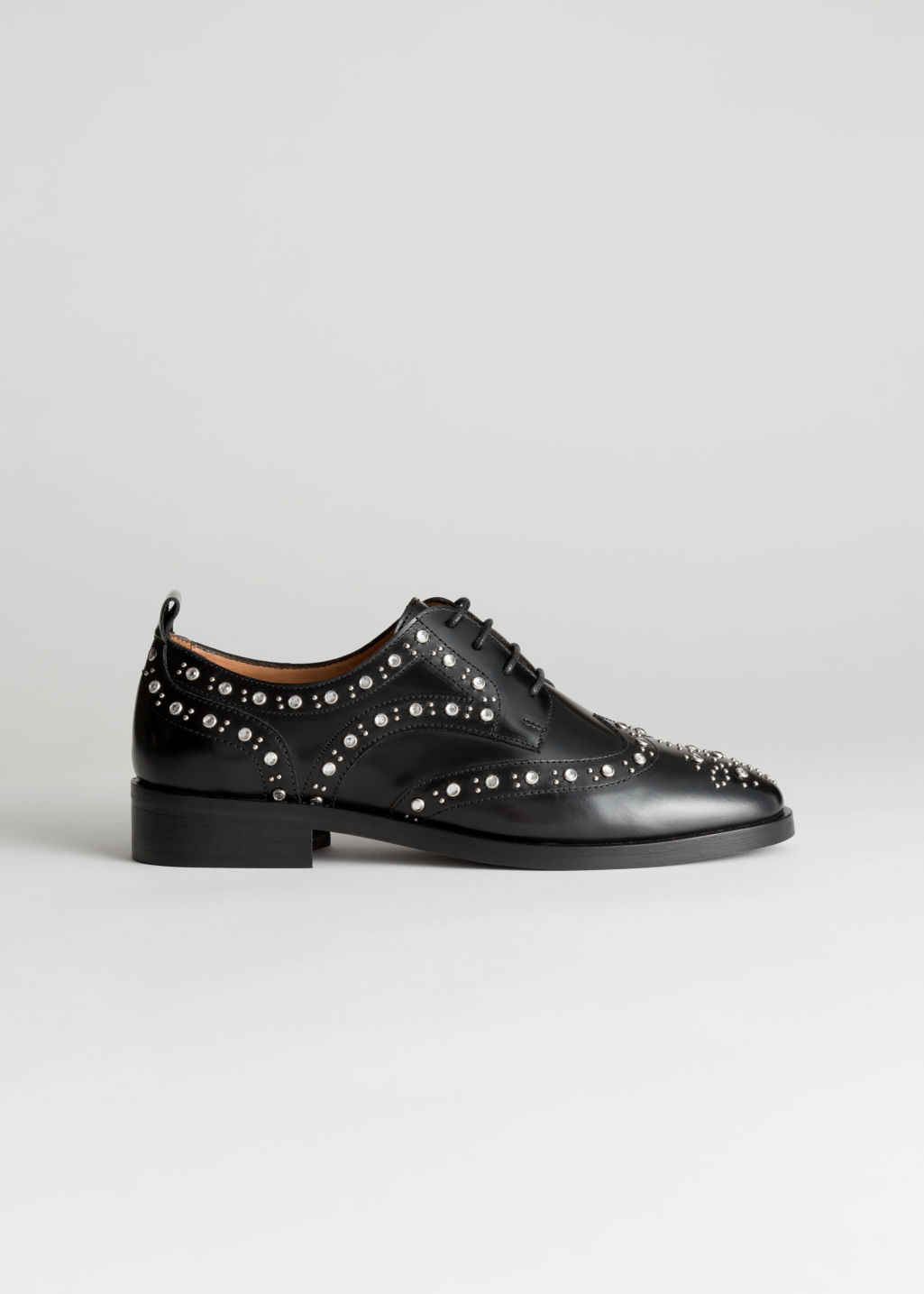 Front image of Stories rhinestone stud leather brogues in black