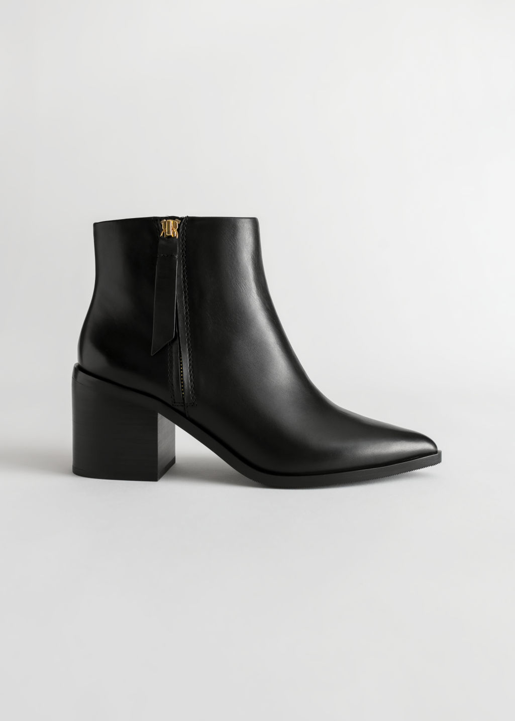 Front image of Stories pointed ankle boots in black