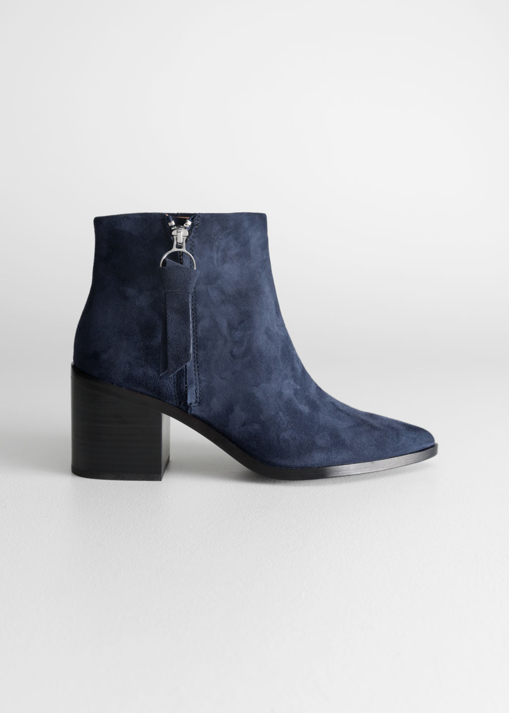 Front image of Stories pointed ankle boots in blue