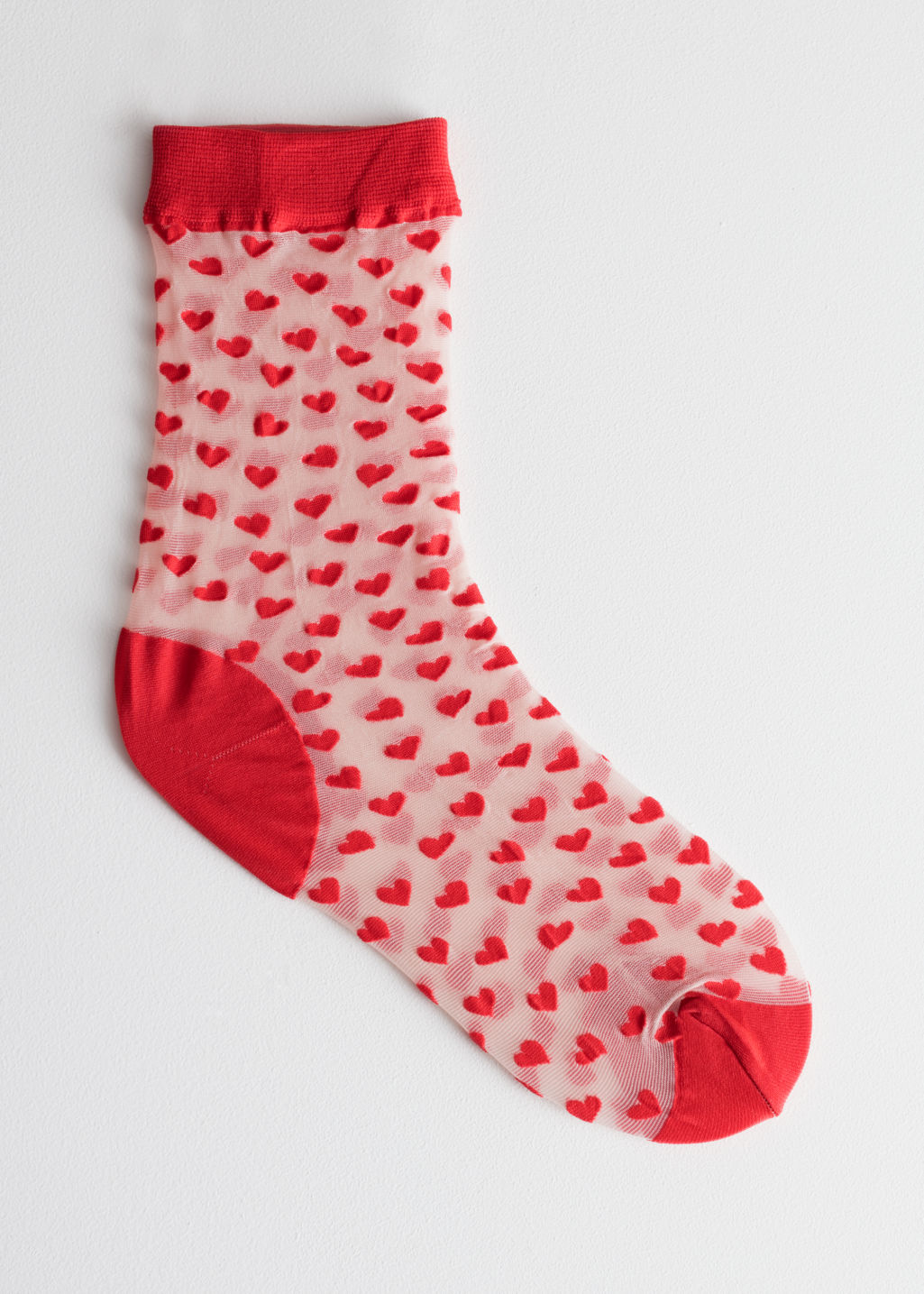 Front image of Stories sheer heart print socks in red