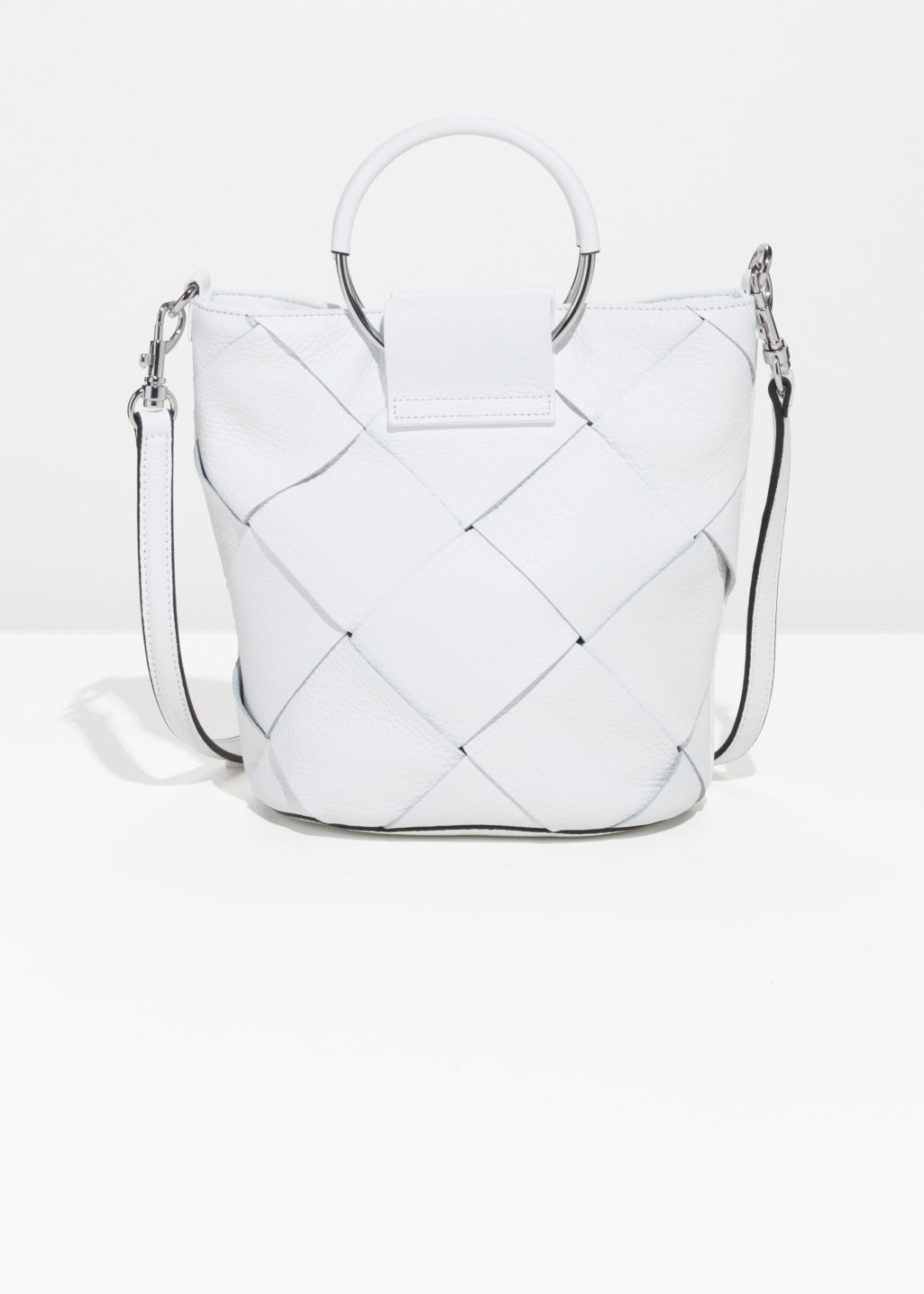 Front image of Stories woven leather bucket bag in white