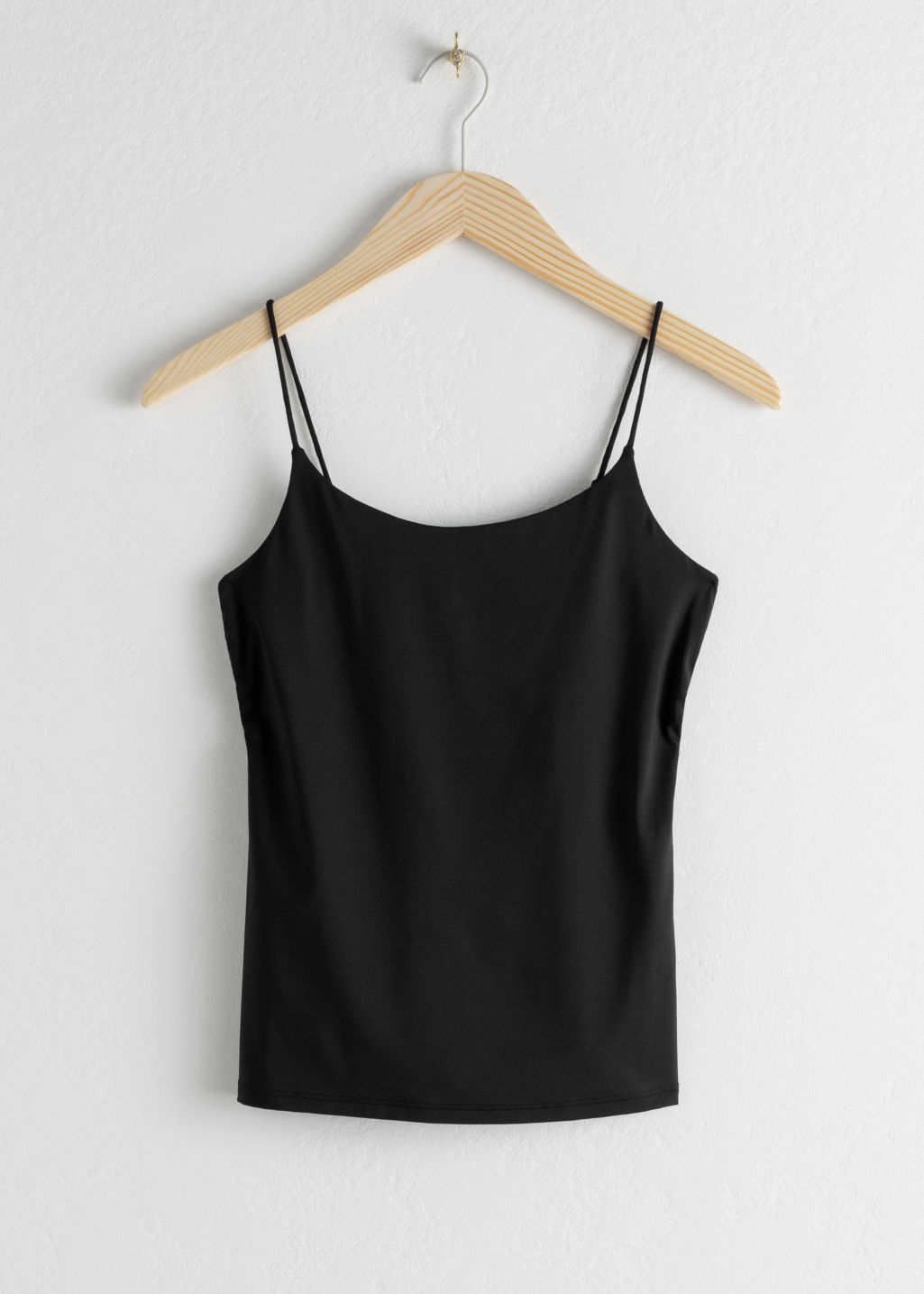 Front image of Stories micro spaghetti strap tank top in black