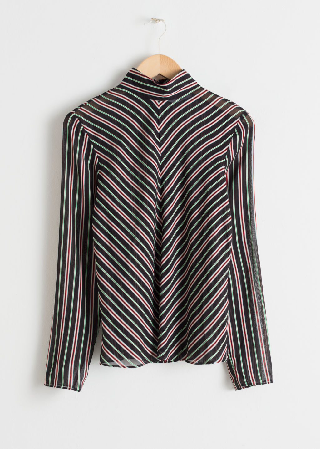 Front image of Stories sheer chevron stripe top  in black