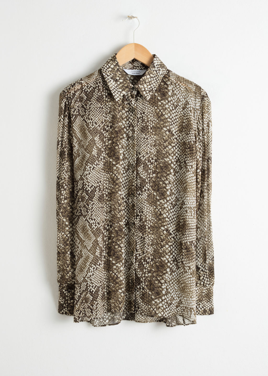Front image of Stories printed button up shirt in animal print