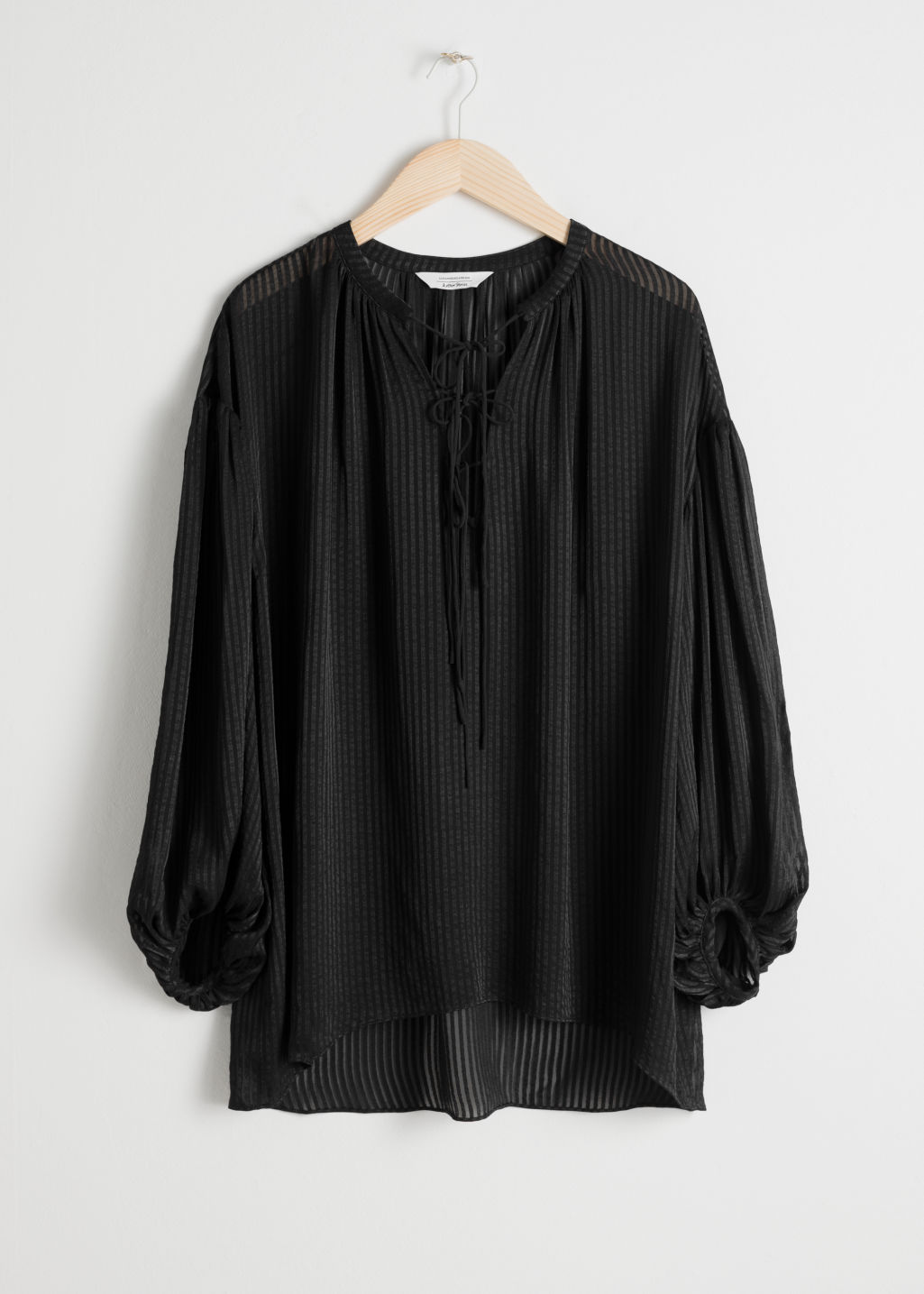 Front image of Stories sheer stripe tie blouse in black