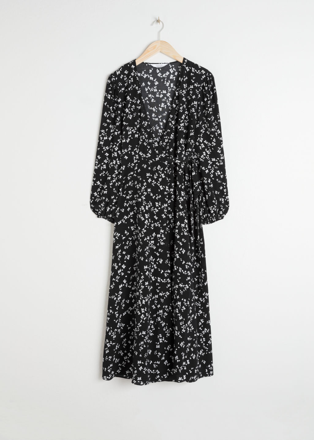 Front image of Stories petal printed wrap dress in black