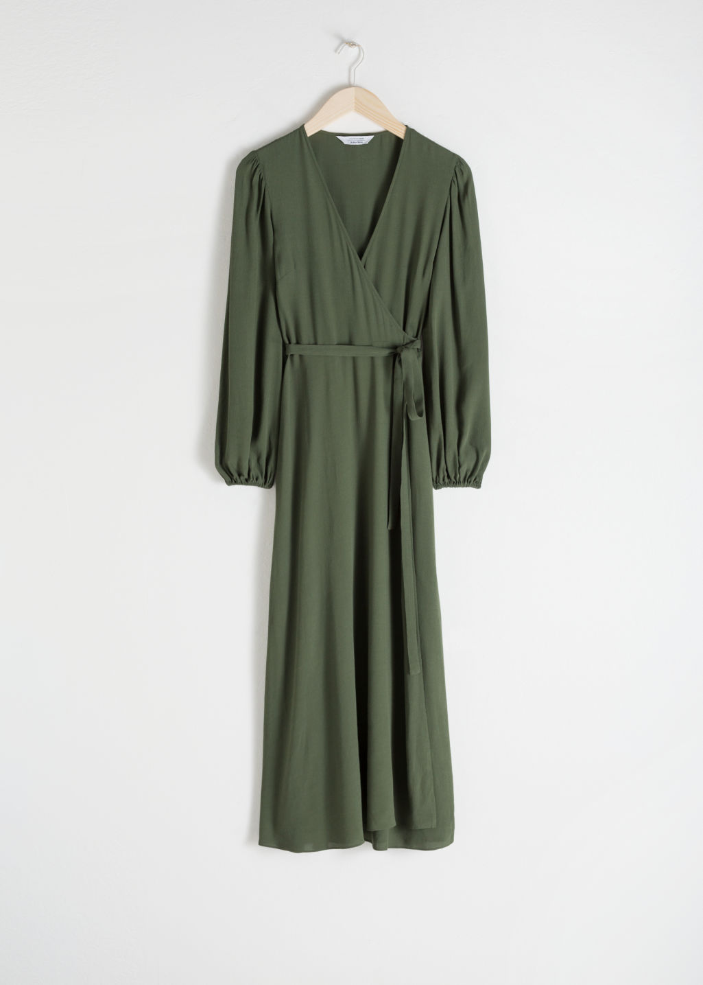 Front image of Stories printed wrap dress in green