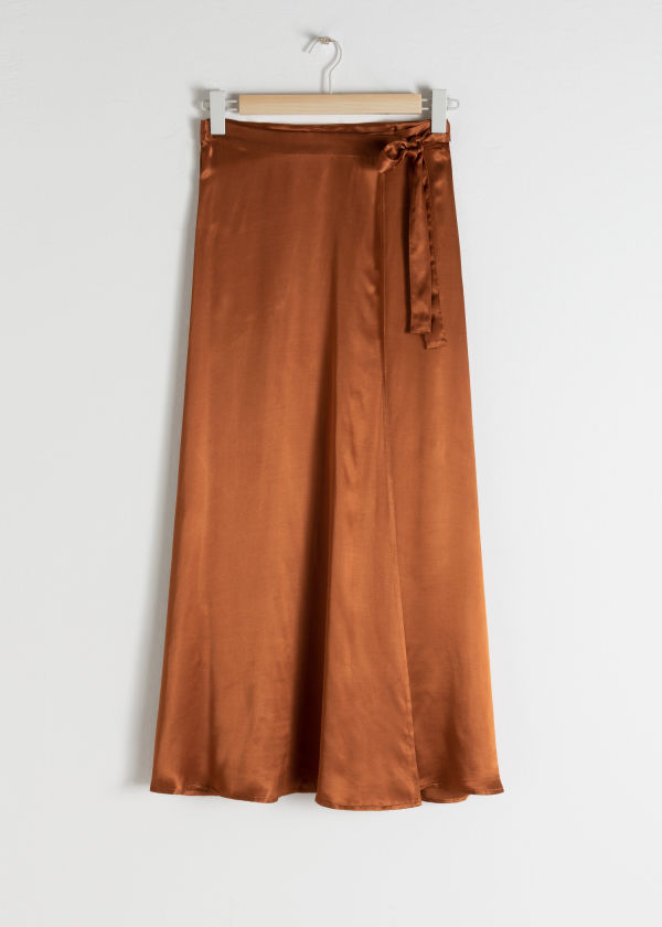 Front image of Stories satin wrap maxi skirt  in orange