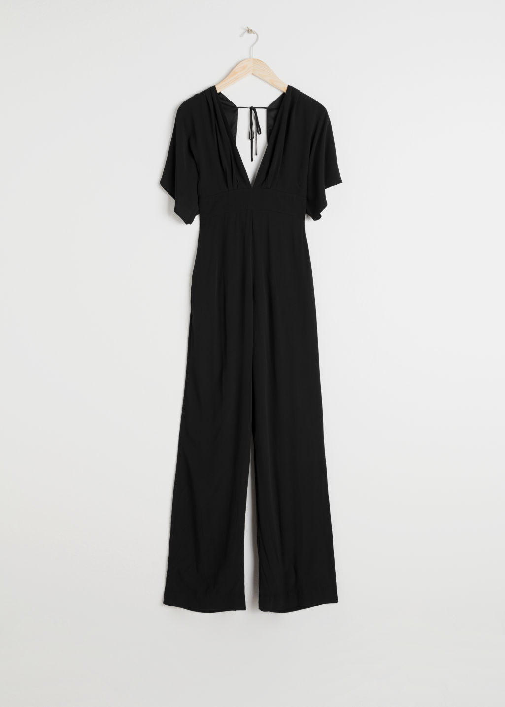 Front image of Stories plunging v-cut jumpsuit in black