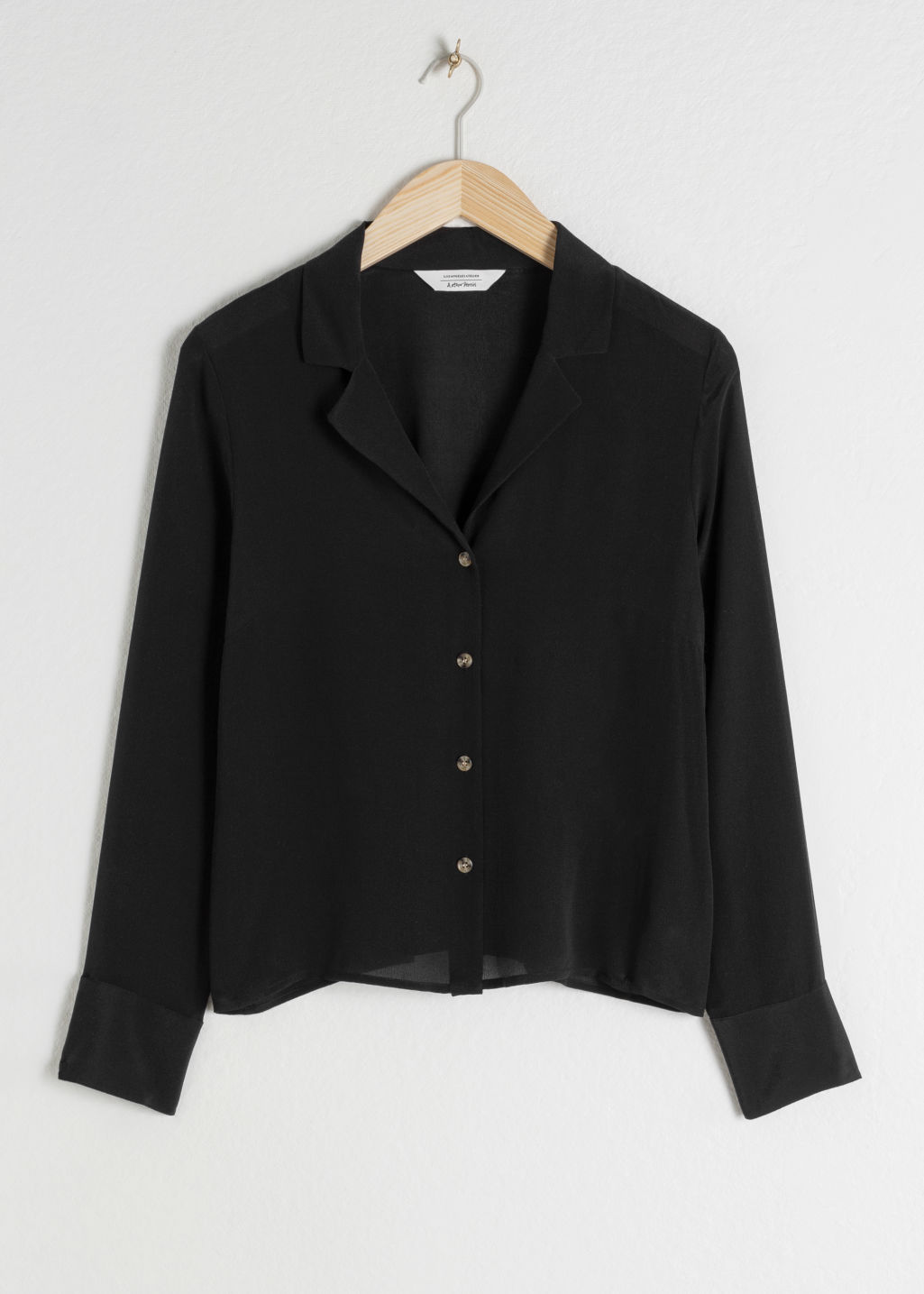 Front image of Stories v-cut silk button down blouse in black
