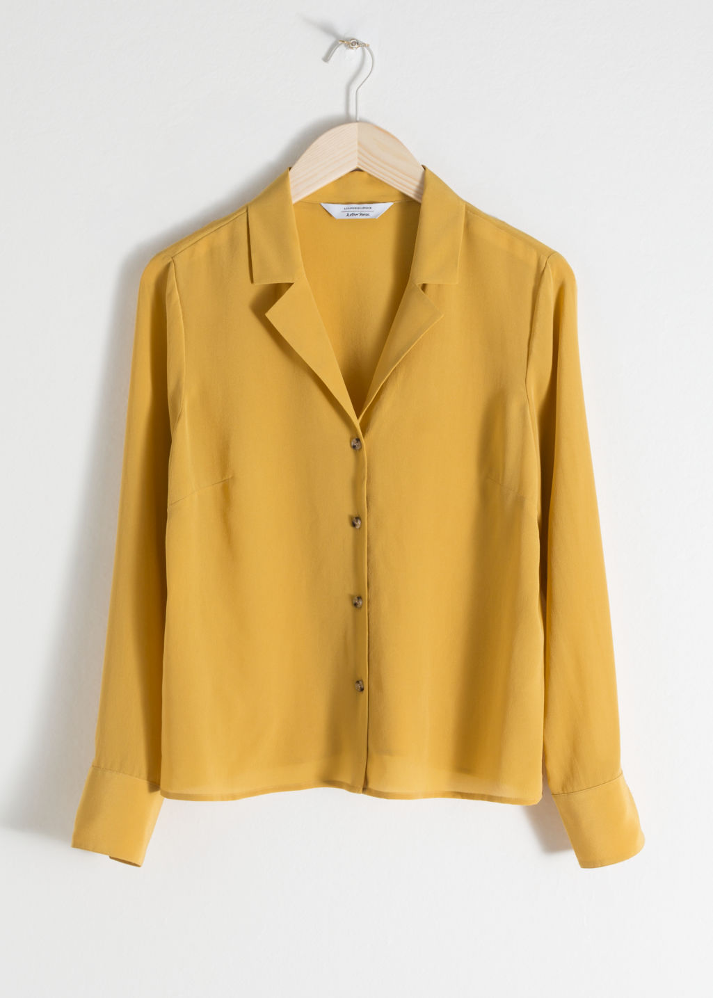 Front image of Stories v-cut silk button up blouse in yellow
