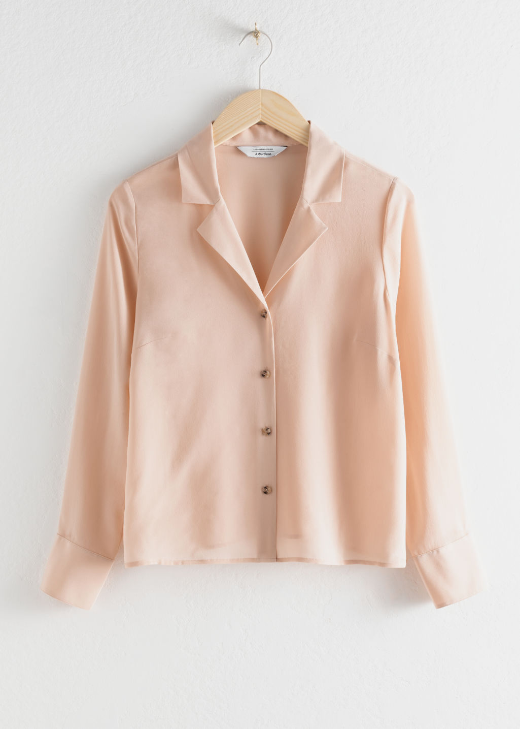 Front image of Stories v-cut silk button up blouse in beige