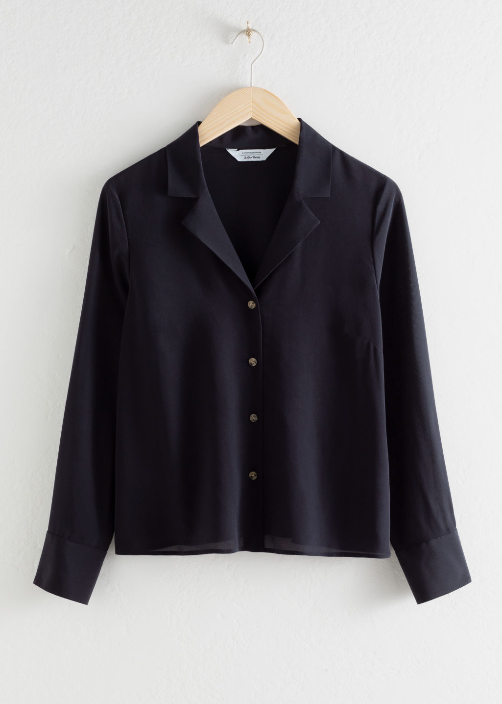 Front image of Stories v-cut silk button up blouse in blue