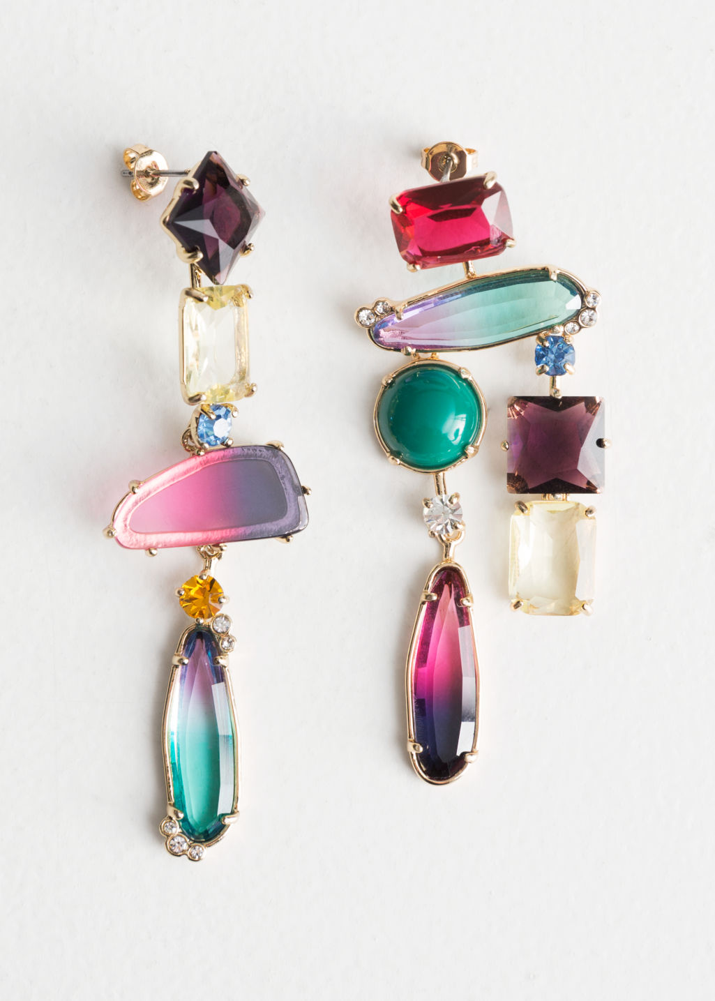 Front image of Stories rainbow rhinestone hanging earrings in pink
